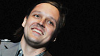 Win Butler from Arcade Fire plays to the Reading crowd