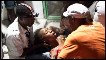 Haitian woman fainting in arms of medic after earthquake