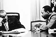 President Lyndon Johnson discussing the Voting Rights Act with Martin Luther King