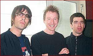Gary flanked by Noel and Liam