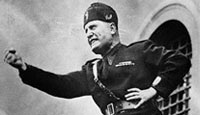 Italian leader Benito Mussolini assumes a characteristic pose as he speaks to an audience in Italy in 1934