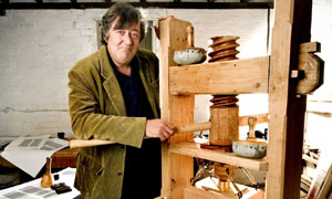 Stephen Fry And The Gutenberg Press: Stephen Fry with replica press