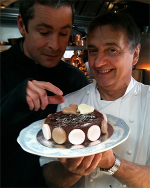 Raymond Blanc with his macaroon cake and cameraman Andy from Raymond Blanc's Kitchen Secrets.