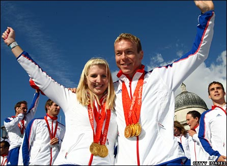 Rebecca Adlington and Chris Hoy show off their medals during Team GB's homecoming parade in London