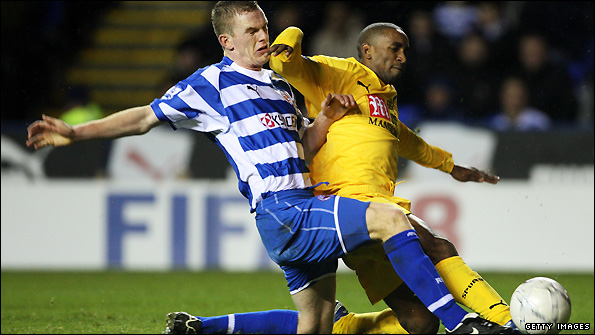 Alex Pearce challenges Tottenham's Jermain Defoe during an FA Cup tie in January 2008