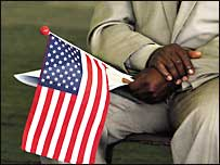 An African man awaits a US citizenship ceremony