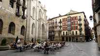 Bar tables in the Plaza Santiago in the Casco Viejo © BBC/Alex Segre. Bar tables in the Plaza Santiago in the Casco Viejo, the old part of town, Bilbao, Vizcaya, Basque Country, Spain