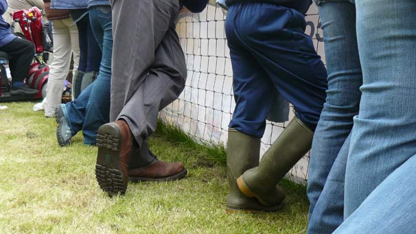 Lining up sensible footwear at the main ring.