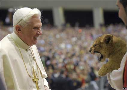 Pope Benedict XVI with a lion cub