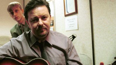 David Brent playing guitar