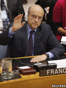 French Foreign Minister Alain Juppe raises his hand to vote in favour of a UN resolution on Libya