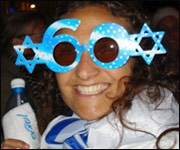 One of the revellers at celebrations for Israel's anniversary