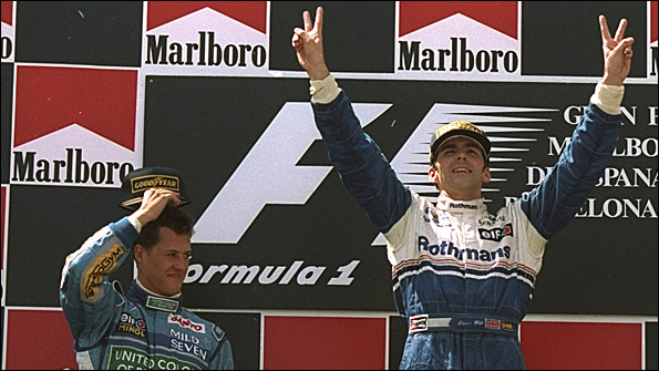 Damon Hill celebrates his win at the 1994 Spanish Grand Prix, with Michael Schumacher alongside him after finishing second