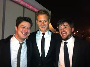 Dan Walker with two band members of Mumford & Sons