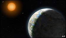 An artist's impression of Gliese 581g and its parent star