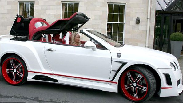 Stephen Ireland's girlfriend and the Bentley (Copyright Cavendish Press)