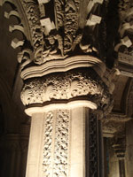 The top of a carved stone pillar