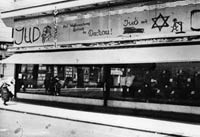 Photograph of a tailor's shop in Vienna defaced with anti-Jewish slogans by Nazi hooligans