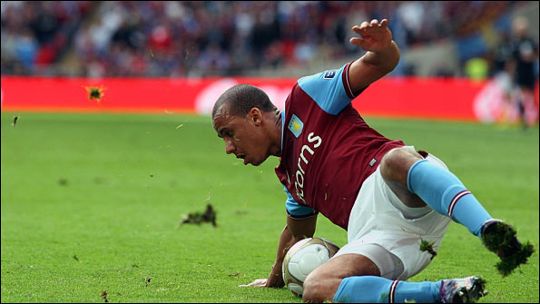 Aston Villa's Gabriel Agbonlahor slips on the Wembley pitch on Saturday