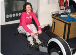 Julie on a rowing machine