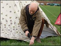 Michael Eavis putting in tent pegs
