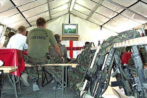 British soliders watch the World Cup between patrols