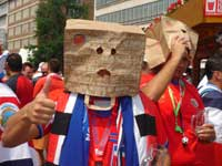 A supporter with a bag on his head...