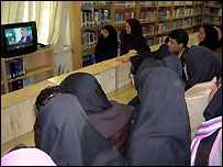 Students in Iran watch the broadcast