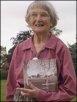 Nora Dixon with her book, Down Poulshot