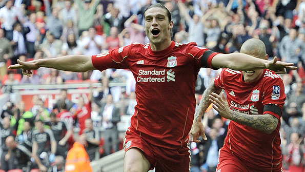 Andy Carroll celebrates his winner against Everton