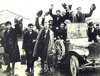 Image of released Republican prisoners beside car