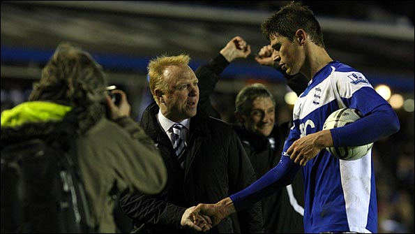 McLeish shakes the hand of Zigic at the end of the match