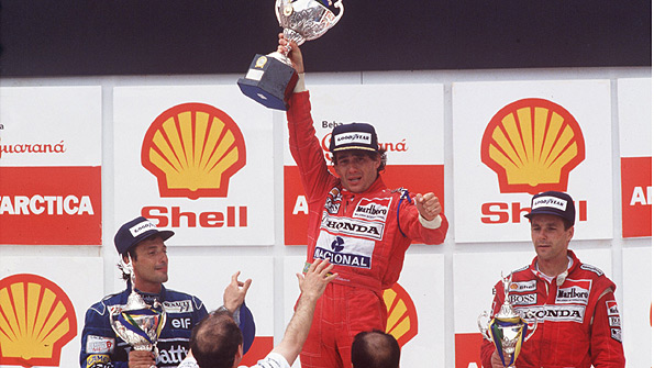 Ayrton Senna on the podium after winning the 1991 Brazilian Grand Prix, flanked by Riccardo Patrese and Gerhard Berger