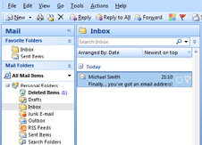 Microsoft Outlook, inbox is selected, email in inbox from Michael Smith starting 'Finally... you've got an email address!'