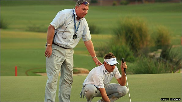Tournament referee Andy McFee (left) consoles Ian Poulter.