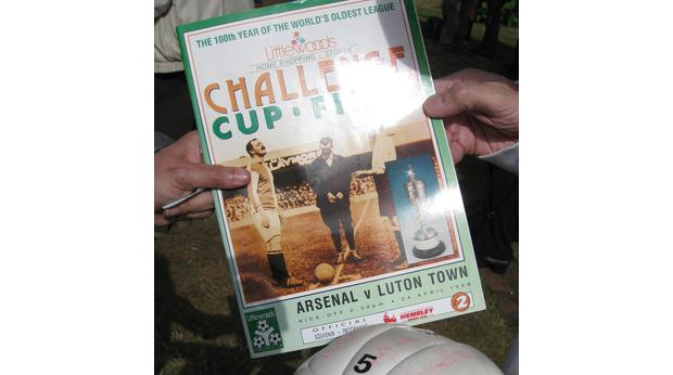 Signed football and programme