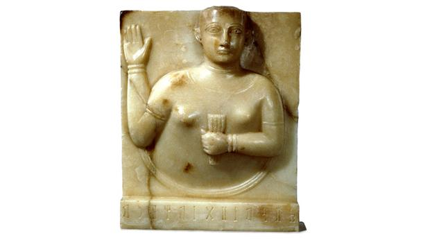 Ancient South Arabian stela showing a woman holding up her right hand. Copyright Trustees of the British Museum