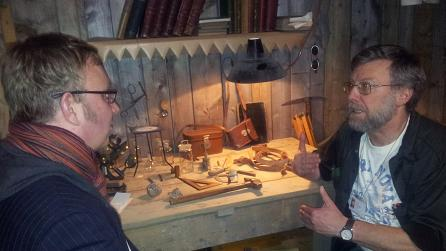 Adam with Dr. Tom Sharpe in the Museum's reconstruction of Scott's hut