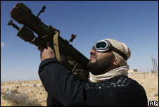 Libyan rebel fighter aiming an anti-aircraft missile