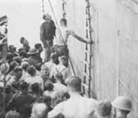 Photograph showing the men being rescued from the Lancastria