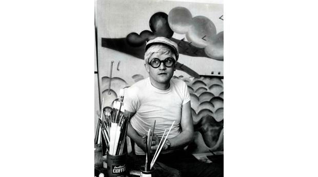 David Hockney, wearing trade-mark hat and glasses, in his studio. Photo: Popperfoto/ Getty Images