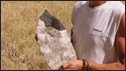 Professor David Thomas with giant stone axe head, Lake Makgadikgadi