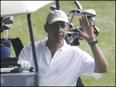 President Obama driving a golf buggy