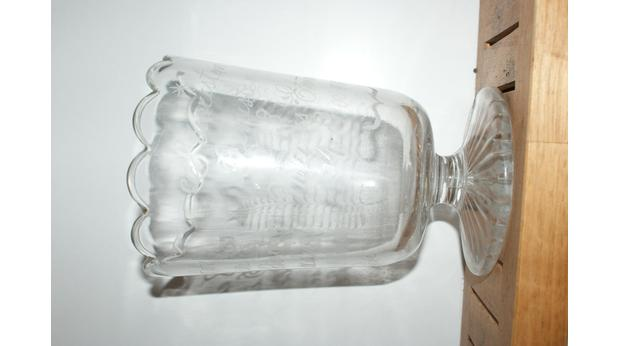 An engraved glass vase