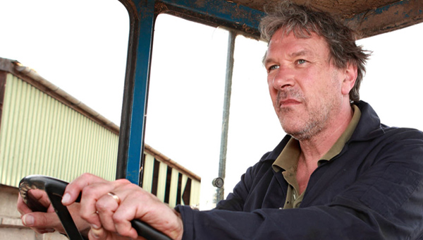 Timothy Bentinck (David Archer) at the wheel of a tractor