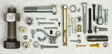 An assortment of metal nuts, bolts and rivets.