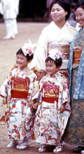 Three-year-old girls dressed up in kimonos