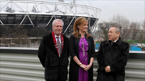 West Ham owners David Gold and David Sullivan and vice chairman Karren Brady pose outside the Olympic Stadium
