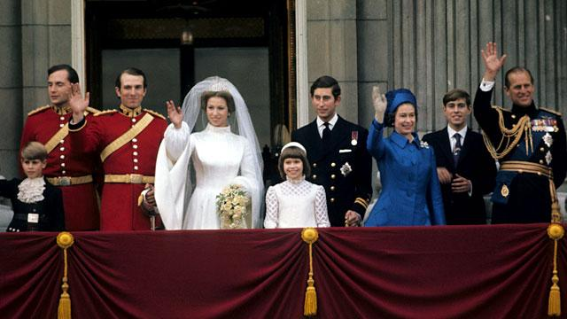Princess Anne, Princess Royal and Mark Phillips wave from the balcony of Buckingham Palace following their wedding, 14 November, 1973.
