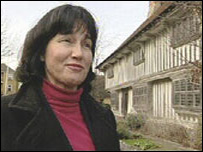 Tina Pullinger in front of the Tudor House